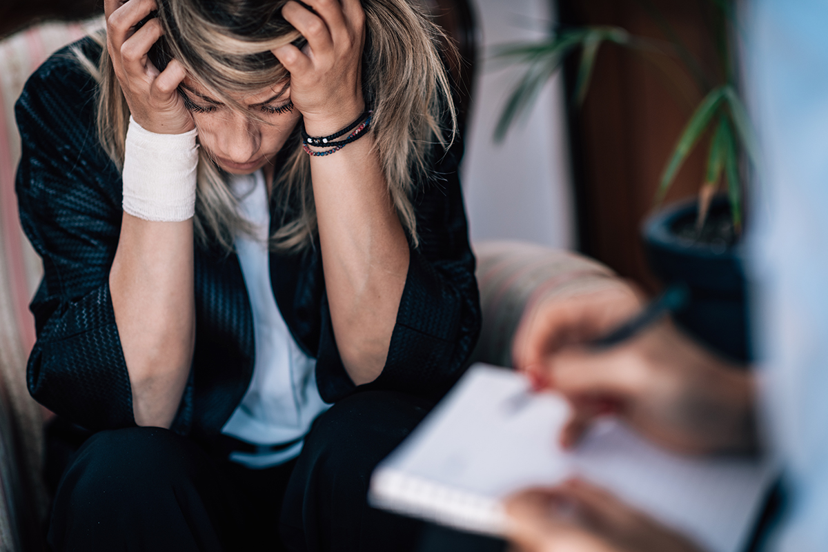 Deppression Concept - Suicidal Female Patient in Psychotherapy Session